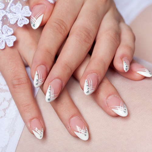 Bride's manicure on lace stockings